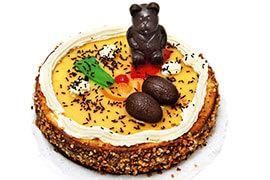 das Bild zeigt einen la Mona Kuchen mit schokoladeneiern